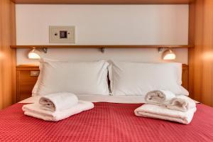 Letto o letti in una camera di Casa Portofino Rooms&Breakfast