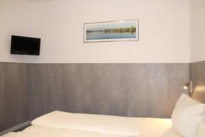 Ein Bett oder Betten in einem Zimmer der Unterkunft CVJM Hotel am Dom