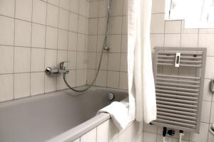 Ein Badezimmer in der Unterkunft CVJM Hotel am Dom