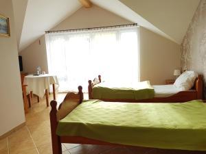 Łóżko lub łóżka w pokoju w obiekcie Hotel Diadem