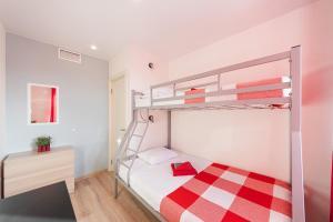 Двухъярусная кровать или двухъярусные кровати в номере Star Home