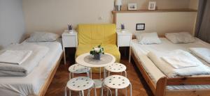 Ein Bett oder Betten in einem Zimmer der Unterkunft Hostel Helvetia