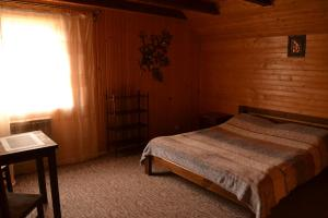 A bed or beds in a room at Faina House
