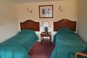 A bed or beds in a room at Red Lion Dunston