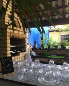 A restaurant or other place to eat at Hostel Caminho da Praia