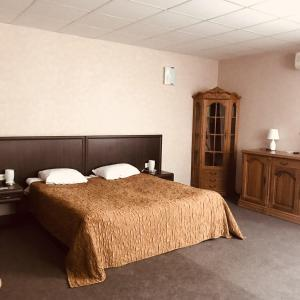 A bed or beds in a room at Skazka Hotel Complex