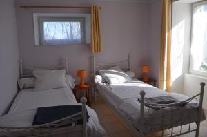 A bed or beds in a room at Logis de Chezelles
