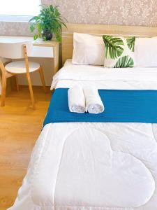 A bed or beds in a room at Tropical House Vung Tau- Melody Apartment