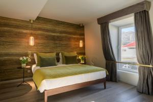 Uma cama ou camas num quarto em Pena D'Água Boutique Hotel & Villas
