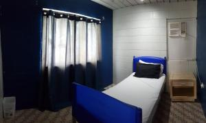 A bed or beds in a room at Asylum Cairns Hostel