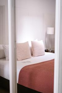 A bed or beds in a room at Trinity Wharf Tauranga