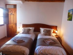 Cama o camas de una habitación en Casita de la Vaca