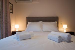 Ένα ή περισσότερα κρεβάτια σε δωμάτιο στο Rodami