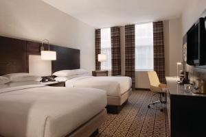 A bed or beds in a room at DoubleTree by Hilton Hotel Boston - Downtown