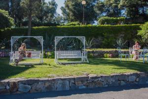 A garden outside Grand Hotel Dei Castelli