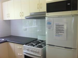 A kitchen or kitchenette at Sunset Waters 6 - Hamilton Island