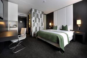 Een bed of bedden in een kamer bij Van der Valk Uden - Veghel