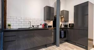 A kitchen or kitchenette at Prestige STAY Aparthotel - 27 Stanley Street
