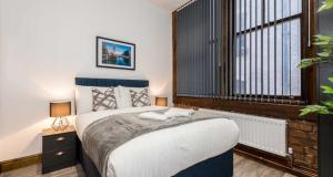 A bed or beds in a room at Prestige STAY Aparthotel - 27 Stanley Street