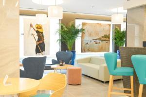 The lobby or reception area at El Puerto Ibiza Hotel Spa