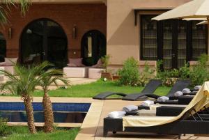 The swimming pool at or near Villa Malika Silvana