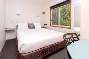 A bed or beds in a room at BIG4 Melbourne Holiday Park