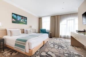 Кровать или кровати в номере Кулибин Парк-Отель & СПА
