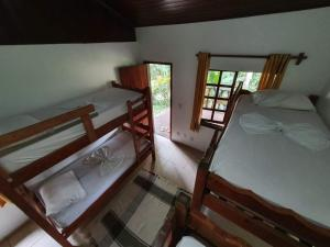 A bunk bed or bunk beds in a room at Pousada Holandês