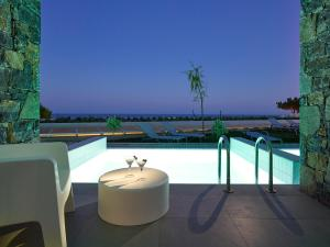 The swimming pool at or close to Kakkos Beach Hotel - Adults Only