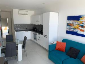 A kitchen or kitchenette at Sea View Penthouse Mellieha Bay