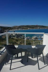 A balcony or terrace at Sea View Penthouse Mellieha Bay