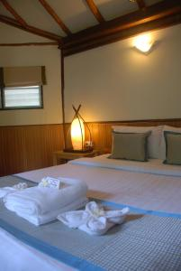 A bed or beds in a room at Montalay - Eco Cottage
