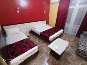 A bed or beds in a room at Vavilon