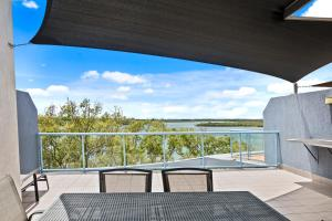 A balcony or terrace at Crystal Waters Picnic Point