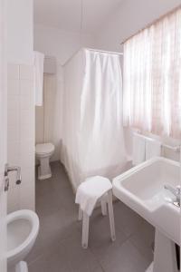 A bathroom at Hotel Maga