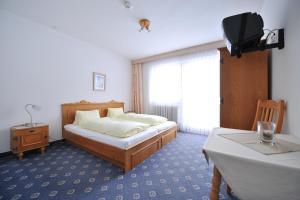 Ein Bett oder Betten in einem Zimmer der Unterkunft Salzburgerhof Jugend- und Familienhotel