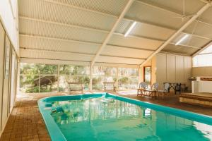 The swimming pool at or near Margaret River Holiday Cottages