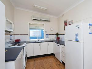 A kitchen or kitchenette at Fingal Beach Shack @ Fingal Bay