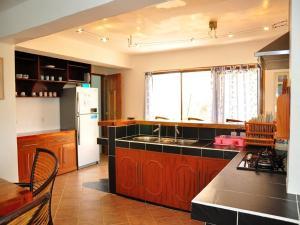 A kitchen or kitchenette at JayJays Club Boracay