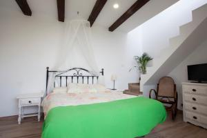 A bed or beds in a room at Casa campo y Playa Taganana