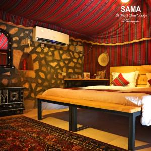 A bed or beds in a room at Sama al Wasil Desert Camp