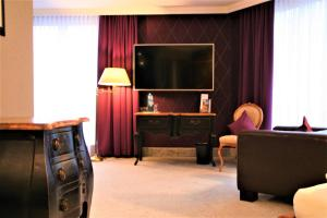 A television and/or entertainment center at Hotel Tanne