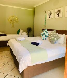 A bed or beds in a room at Celtis Lane Guest House