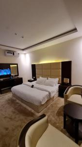 A bed or beds in a room at ترامونتـان