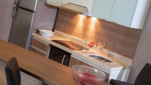 A kitchen or kitchenette at Blue Residence Hotel