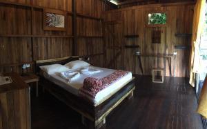 Ein Bett oder Betten in einem Zimmer der Unterkunft Casa Torre Eco- Lodge