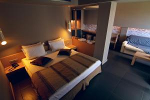 A bed or beds in a room at Elysion Hotel