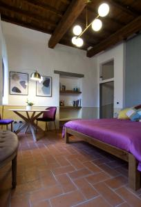 A bed or beds in a room at Ardiglione Apartment