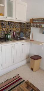 A kitchen or kitchenette at Résidence LA VILLA