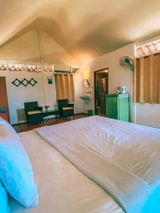 A bed or beds in a room at Holiday Resort